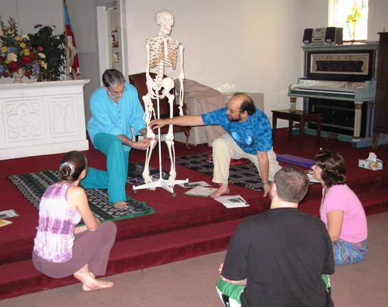 Larry Terkel and Matt Lerner lead a class on anatomy with a class of Yoga Teacher trainees